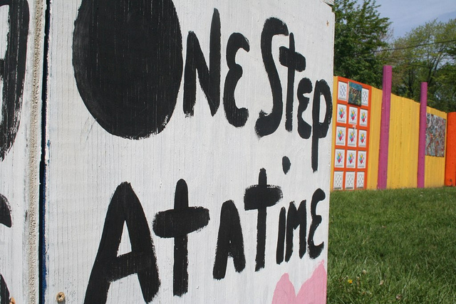 One step at a time sign